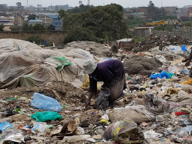 A woman waste picker at the Dandora dumpsite in Nairobi, Kenya