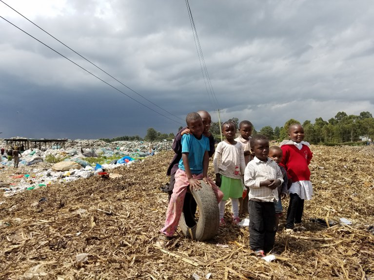 Children smile during a CCAC fact-finding mission to Kajiado dumpsite, Kenya.