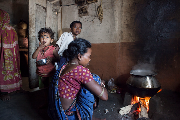 Woman cooking on a traditional (mud) stove. Photo credit: Tanvi Mishra