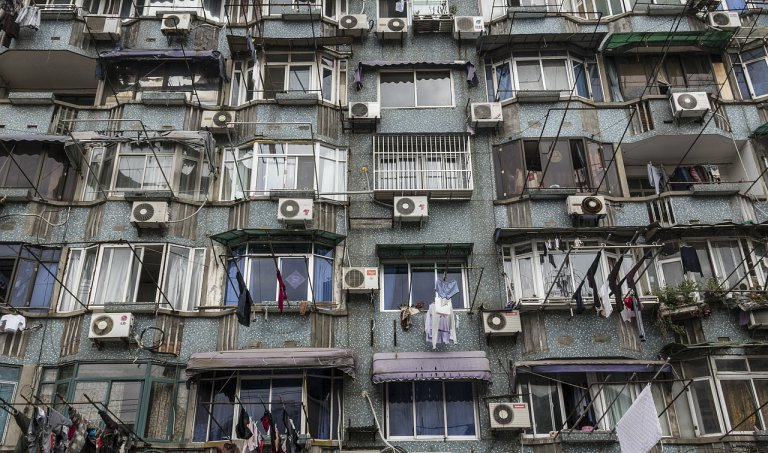 apartment building and balconies with multiple air conditioners