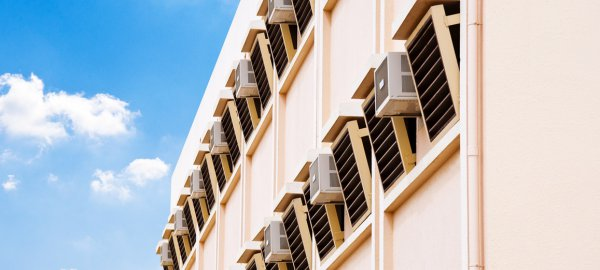 apartment block wall with AC units