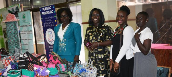 Women showcase products produced using recycled waste
