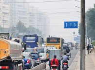 traffic jam, people riding motorcycle, buses, cars and heavy transport